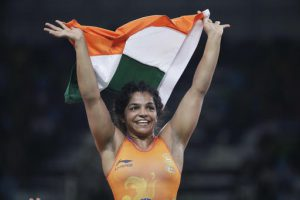 India's Sakshi Malik reacts after winning bronze against Kyrgyzstan's Aisuluu Tynybekova in the women's wrestling freestyle 58-kg competition at the 2016 Summer Olympics in Rio de Janeiro, Brazil, Wednesday, Aug. 17, 2016. (AP Photo/Markus Schreiber)